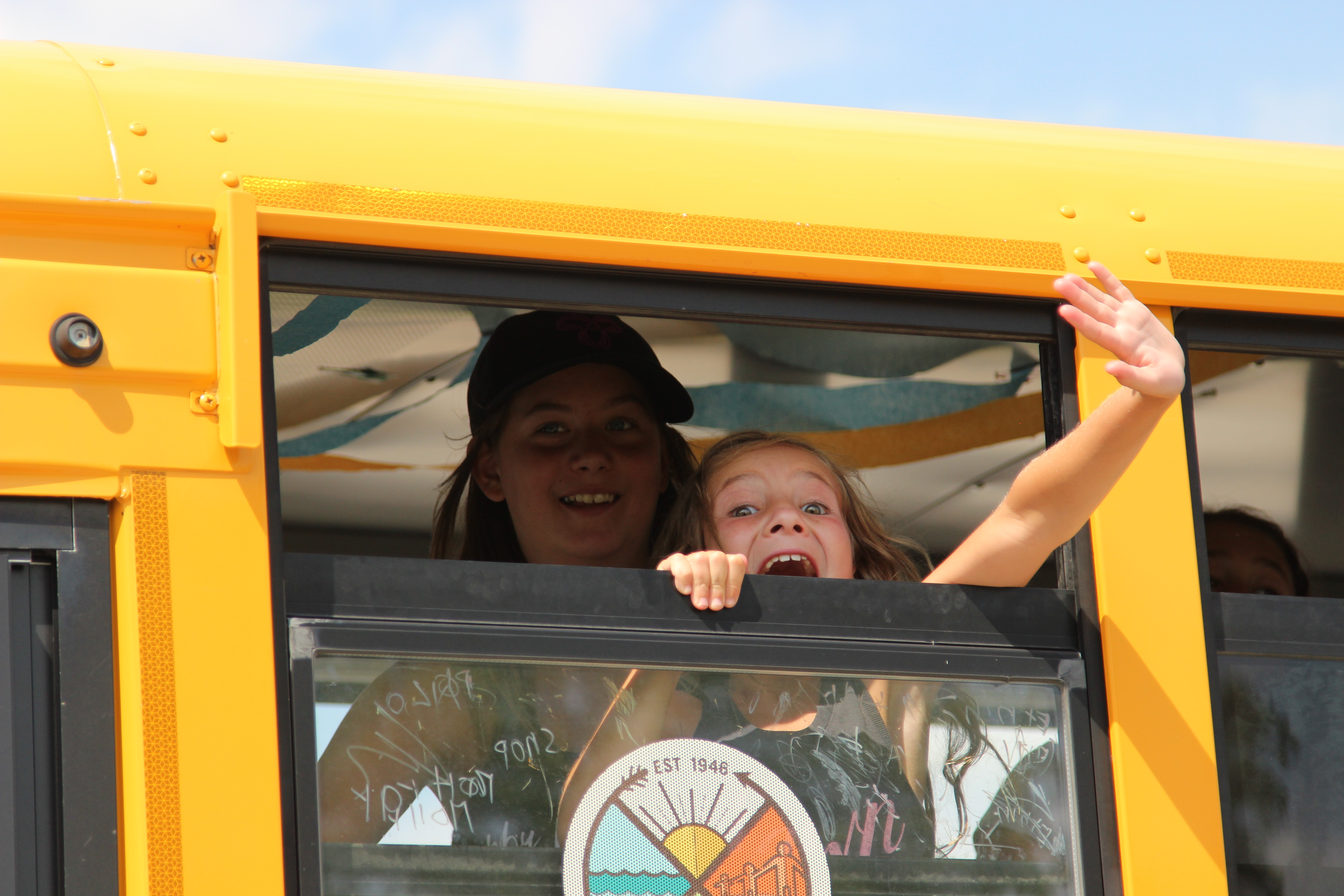 Waving goodbye from the Camp Robin Hood bus. Camp Robin Hood is Canada's oldest and largest day camp.