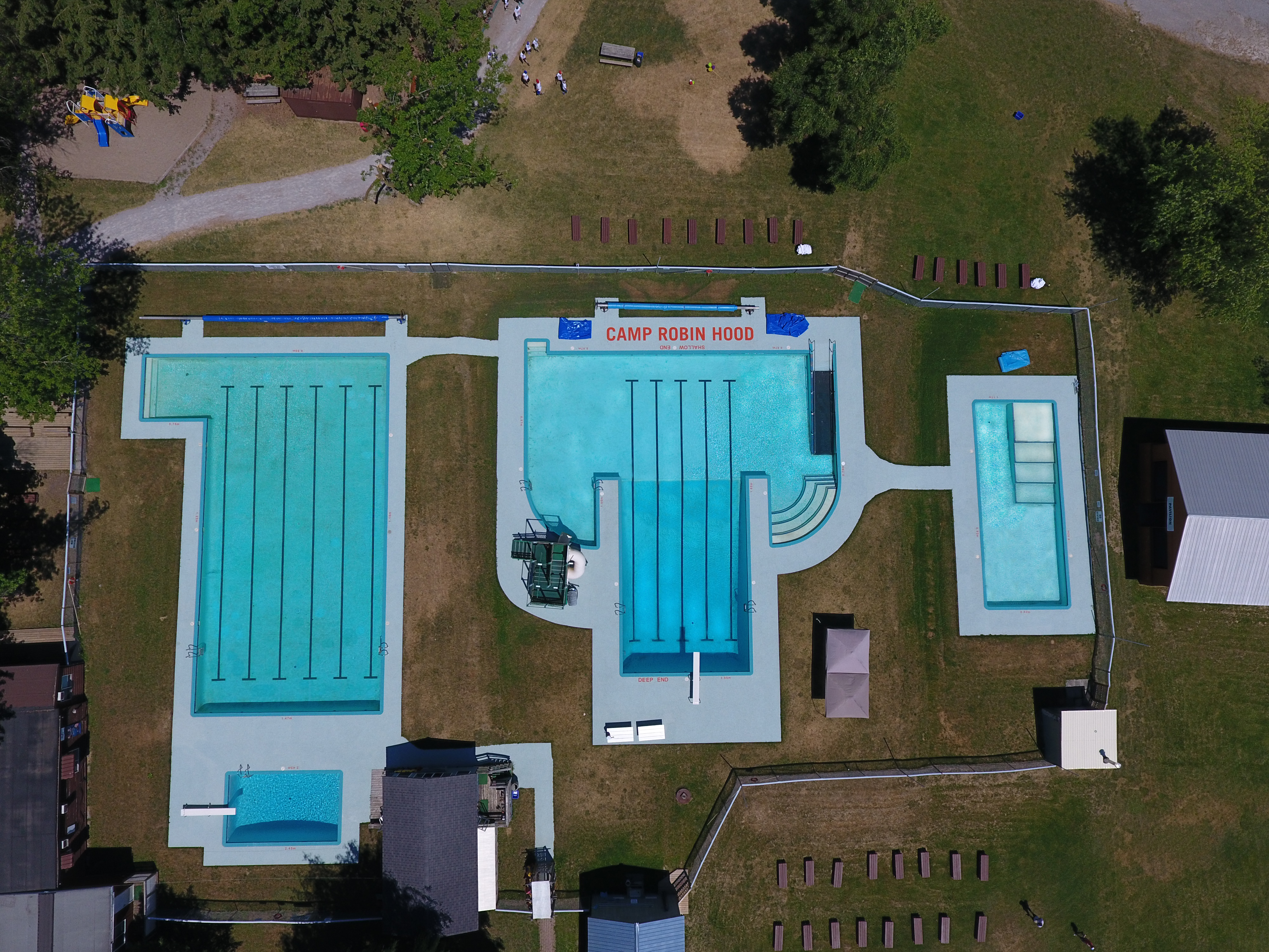 Aerial Photo of 4 heated swimming pools at the oldest and largest day camp in Canada, Camp Robin Hood